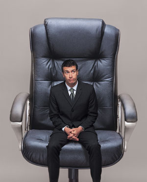 Small Man in a Big Chair